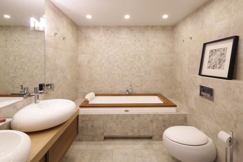 tub deck beige mosaic wall and floor tile recessed lighting white sink bowls artwork toilet wall mirror wooden floating vanity tub filler built in tub
