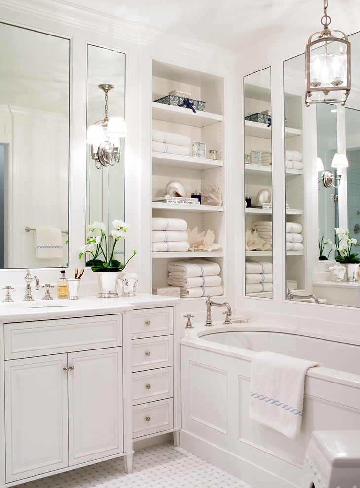 tub deck built in shelves white vanity sink faucet wall sconces wall mirrors drawers towels farmhouse chandelier mosaic floor tile built in tub