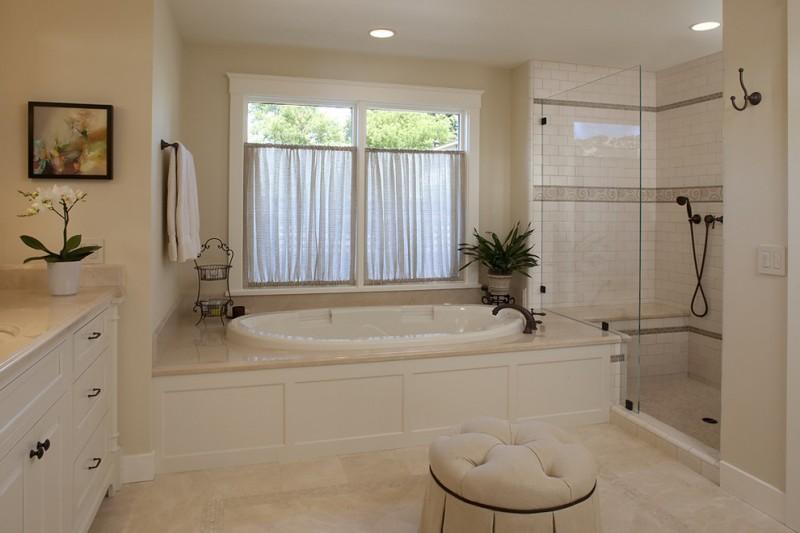 tub deck glass windows curtains one piece tub deck built in bathtub white vanity tufted ottoman glass shower doors black shower fixture