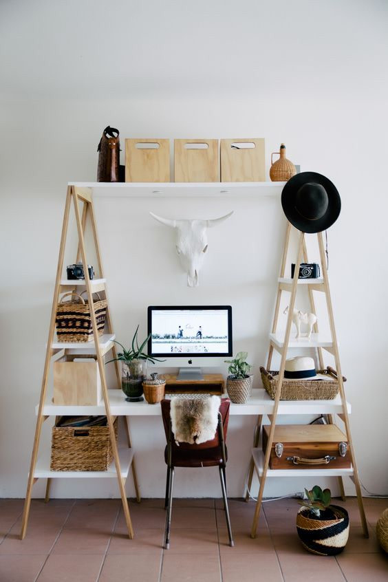 two ladders with shelves, white board for table between, brown floor tiles, white tiles, marroon chair