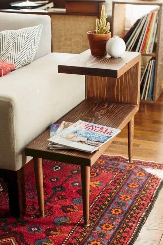 unique wooden end table with lanky legs, rug, wooden floor, white sofa