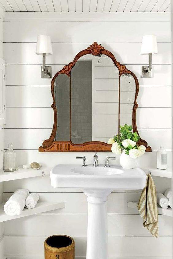 vintage mirror, white sink, white wooden plank, white sconce, white corner floating shelves, white wooden ceiling