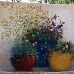 Wall With Painted Plants On Colorful Pots