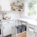 White Drawers With Two Trash Bins, Drawers Cabinets Under White Top, White Wall Tiles, Wooden Floating Shelves