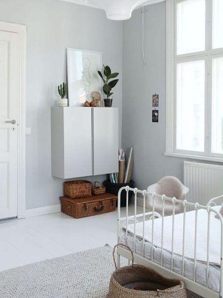 white floating cabinet on white bedroom, white floor, white walls, white metal platform