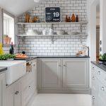 White Kitchen, White Wooden Floor, White Wall, White Subway Tiles, White Ceiling, Light Grey Cabinet, Black Marble