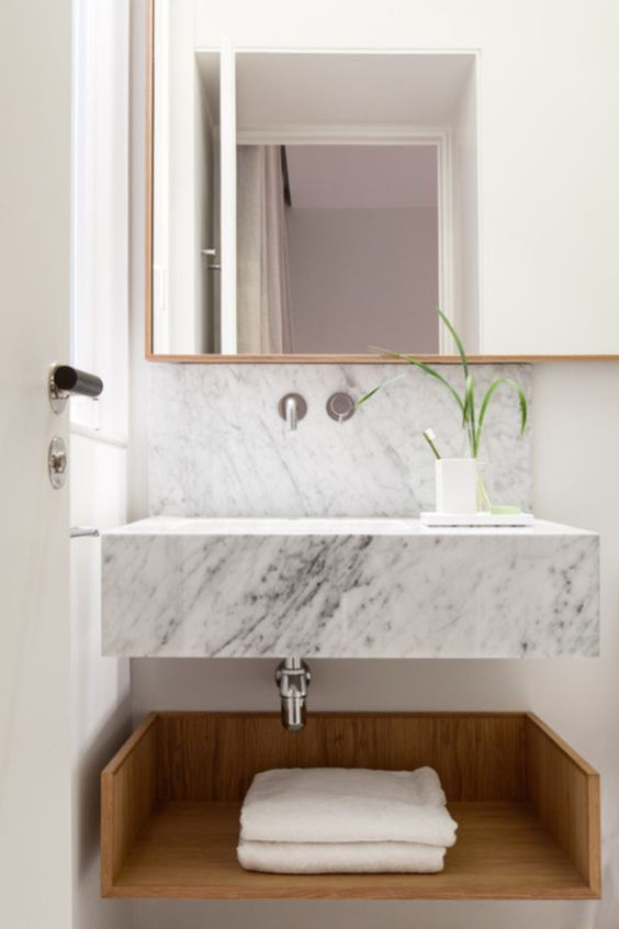 white marble floating vanity, backsplash, square mirror with wooden frame, wooden floating tray under the vanity