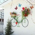 White Wall, Floating Pots With Fake Fruits And Flowers, Painted Bicycle