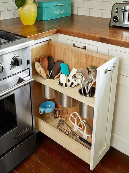 white wooden cabinet under wooden top with opened side, holes for collecting kitchenware