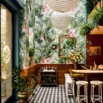 Wooden Bar, White Rattan Stool, Black White Diamond Floor Times, Leave And Flowers Patterns On Wall, Plants On The Ceiling, White Global Pendant