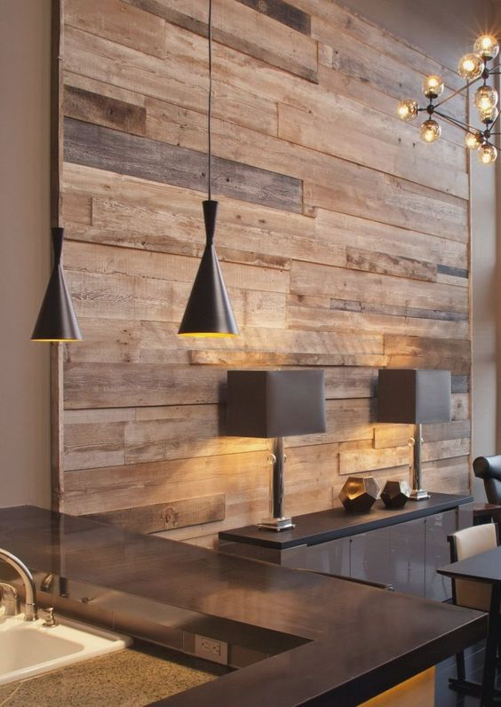 wooden covering accent wall, grey cabinets, dark grey, black cone pendants, sink