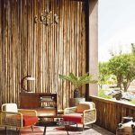 Wooden Covering Wall On The Porch, Earthy Floor Tiles, Rug, Wooden Chairs, Coffee Table, Cabinet, Chandelier
