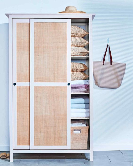 wooden cupboard with rattan sliding door, grey floor, white wall