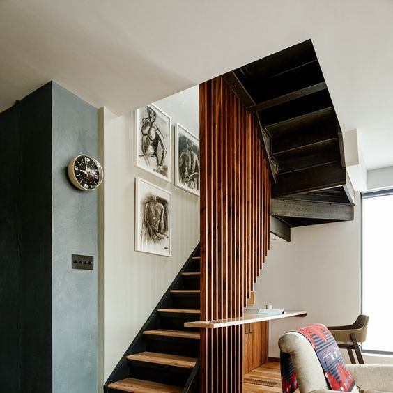 wooden slats half partition, floating shelves, wooden stair, wooden floor, chair, white wall,