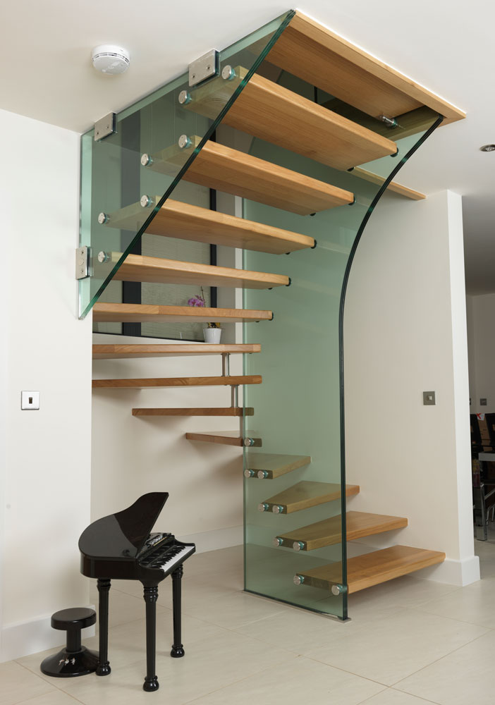 wooden stairs with acrylic support, floor tiles, white wall