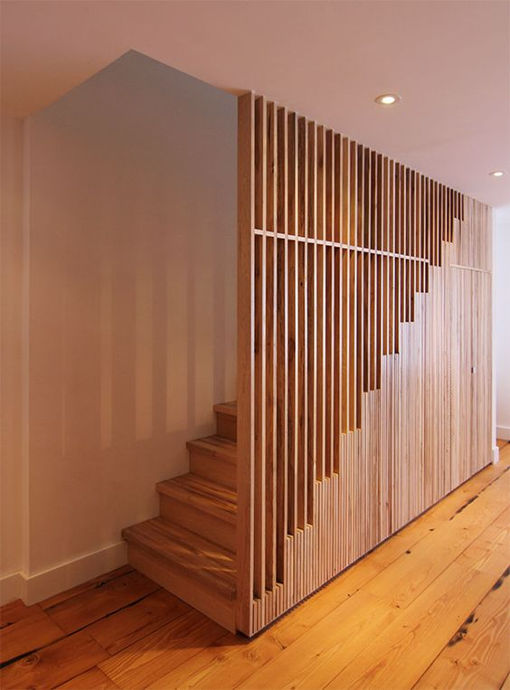 wooden stairs with wooden slat railing, wooden floor
