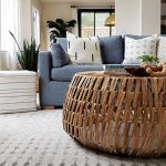 Woven Round Table, Grey Rug, Blue Sofa, White Wall