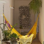 Yellow Hammock With Fringe On Outdoor Hall, Brown Floor Tiles, Outdoor Wall Tiles, Plants