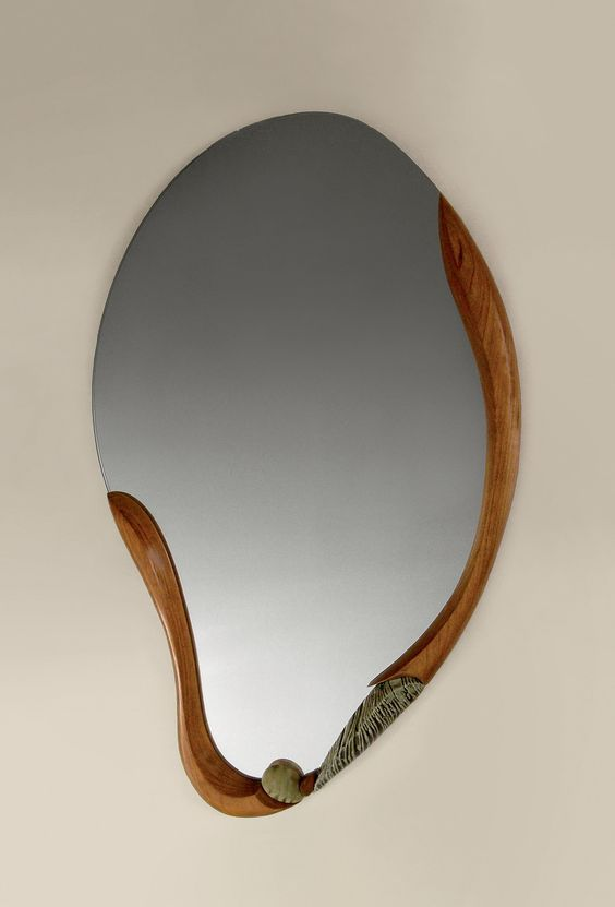 asymmetric mirror with wooden frame under the mirror only