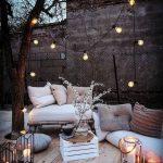 Backyard Corner, Wooden Floor, Wooden Bench With White Cushion, White Cushion On The Floor, White Crate Box, Ottoman, Lamps, Pillows