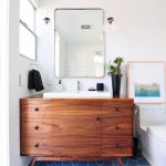 Bathroom, Blue Floor Tiles With Geomteric Lines, Dark Wooden Vanity, White Undermount Sink, White Wall, White Toilet, Mirror, Bulbs Pendants
