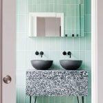 Bathroom, Green Wall Tiles, Black Marble Vanity With Two Black Bowl Sink, Patterned Floor Tiles, Mirror