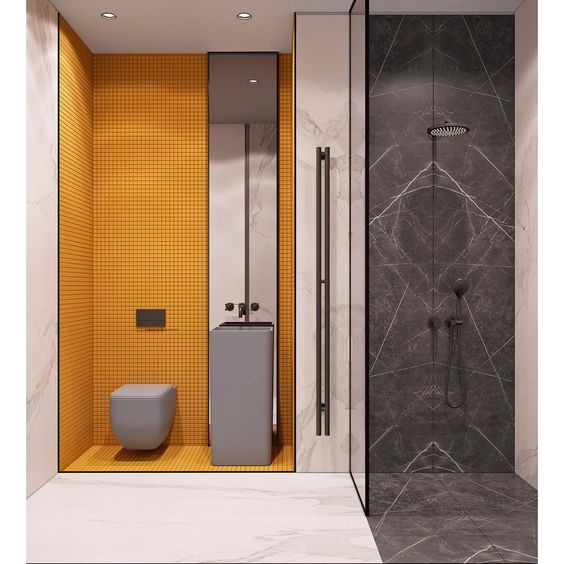 bathroom, grey marble on the shower area, white marble outside, yellow tiny tiles on toilet area, grey floating toilet, grey tall vanity, mirror