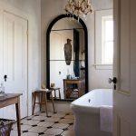 Bathroom, White Black Tiles, White Wall, Crystal Chandelier, White Tub, Windows, Wooden Table, Wooden Stool