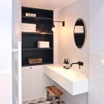 Bathroom, White Subway Wall Tiles, White Floating Sink, Round Mirror, Black Built In Shelves, Patterned Tiles
