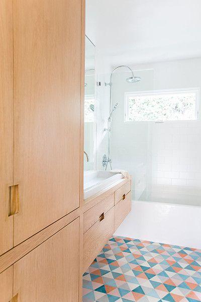 bathroom, white wall tiles, wooden floating vanity built in with wooden cupboard, colorful floor tiles