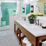 Beachy Bathroom Blue Glass Tile Window Skylight Wooden Vanity Sink Marble Top Rustic Faucets Wall Mirrors Wall Sconces White Subway Tile Built In Bench Shower Fixture Rattan Baskets