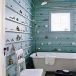 Beachy Bathroom Blue Wall Blue Mini Shelves Starfish Coral Square Window Gold Shower Curtain Rod Freestanding Bathtub White Chair Window Shade Black Wooden Stool