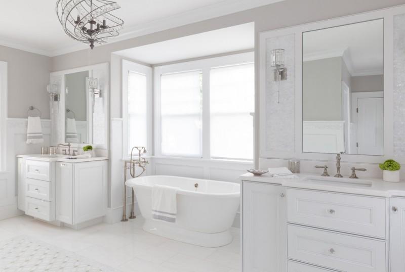beachy bathroom rustic coastal chandelier glass wall sconces windows freestanding tub white vanities faucets wall mirror window shade tub filler towel ring