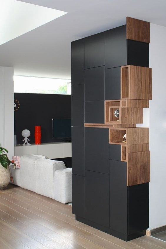 black cabinet wall partition, brown wooden shelves on the right side