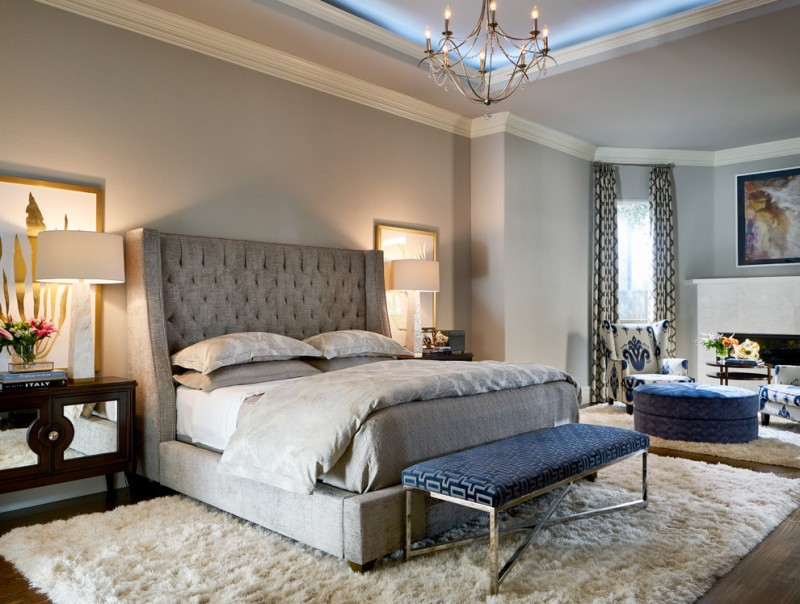 blue and gray bedroom chandelier gray bed gray headboard shag rug blue bench blue ottoman gray walls mirrored nightstands white table lamps fireplace