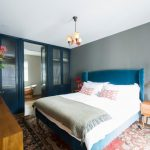 Blue And Gray Bedroom Grey Wall Blue Doors Tub Blue Bed Blue Velvet Headboard Wooden Nightstand Red Table Lamps Dresser Mediterranean Rug White Bedding
