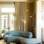 Blue Velvet Curvy Sofa With Silvery Look, Wooden Floor, Wooden Wall, Beige Ceiling