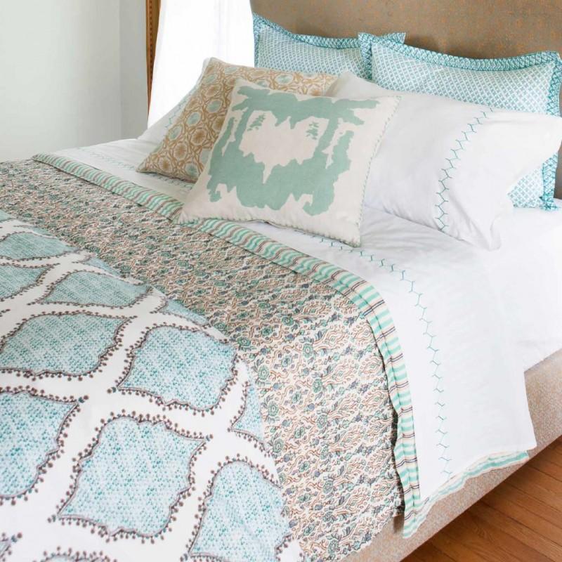 bohemian duvet cover blue and white pillows beige gold headboard beige bed white blue bedding wooden floor windows white curtain