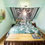 Bohemian Duvet Cover Sloped Ceiling Indoor Plant Bamboo Table Wooden Floor Pillows Fabric Decoration Chandelier Wooden Nightstands Green Walls Window