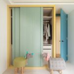 Built In Cupboard With Green Sliding Door, Yellow Frame, Drawers And Shelves Inside