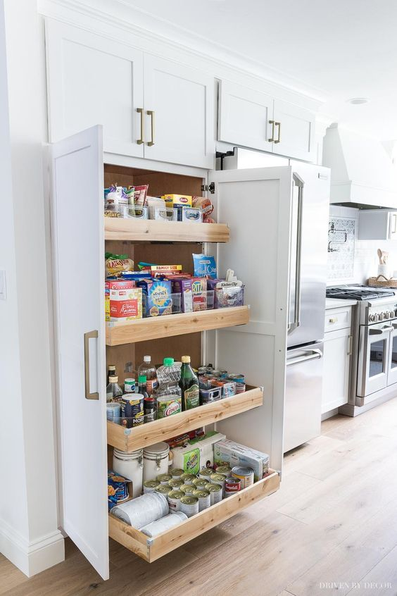 built in pantries with wooden low drawers