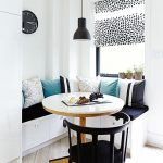 Corner Dining Nook, White Built In Bench With Storage, Black Cushion, Pillows, Black Pendant, White Round Table, Black Chair
