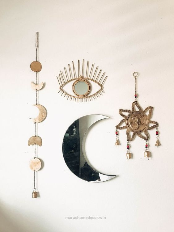 crescent shaped mirror surrounded with wall decorations