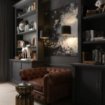 Dark Bookcase On Dark Wall, Leather Chair, Brown Rug In The Middle
