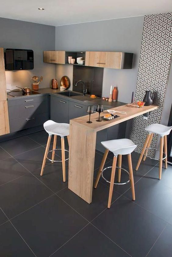 dark grey kitchen, black floor, wooden island, white stool, grey cabinet, floating wooden cabinet with shelves, decorative wallpaper