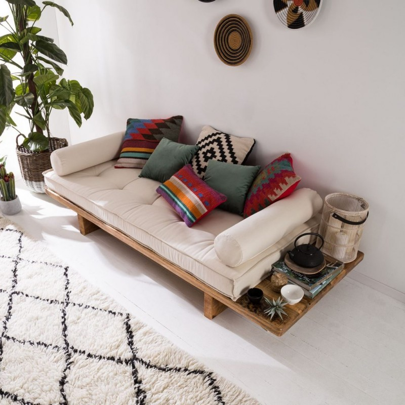 daybed with wooden platform, white cushion, pillows, white rug, white rall