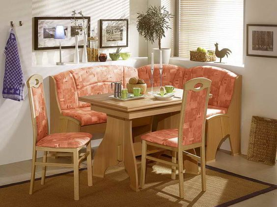 dining nook, polished wooden bench and chair with pink cushion, wooden table with details