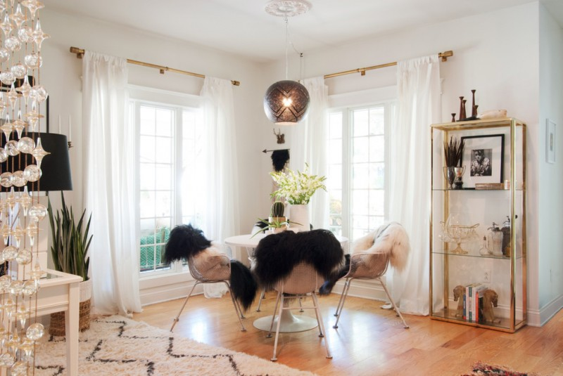 drapery pole white drapes pendant lamp golden rack shag area rug ghost chairs shag chair throws white framed glass windows black pendant lamp