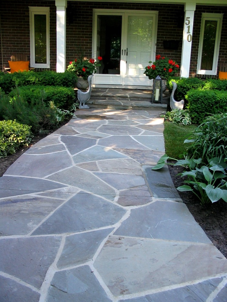 flagstone walkway design ideas plants outdoor decorations canlde white and glass doors white framed glass windows stairs wooden chairs