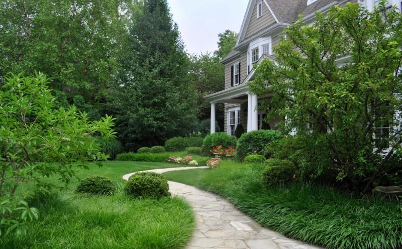 flagstone walkway design ideas white and gray house plants white framed glass windows white framed glass doors white pillars